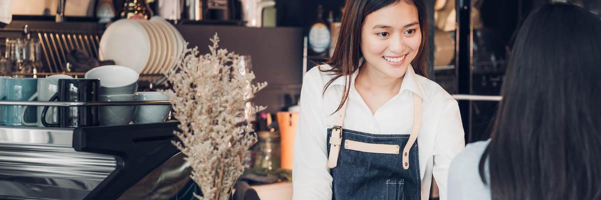 A smiling barista